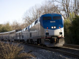 Passenger Train Rushes Forward, Silver Spring, Maryland Photographic Print by Stephen St. John