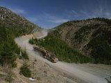Log Trucks Carry Old Growth Logs Down a Mountain Reproduction photographique par James P. Blair