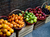 Six Baskets of Assorted Fresh Fruit for Sale at a Siena Market, Tuscany, Italy Fotografisk tryk af Todd Gipstein