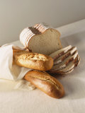 Partly Sliced Bread and Baguettes Fotografie-Druck von Diana Miller