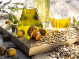 Various Oils in Carafes, Olives, Sunflower Seeds Photographic Print by Peter Rees