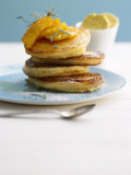 Pancakes with Orange Slices and Maple Syrup