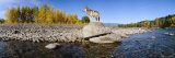 Wolf Standing on a Rock at the Riverbank, US Glacier National Park, Montana, USA Fotografisk trykk av Panoramic Images,