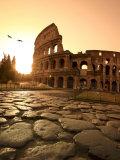 Colosseum og Via Sacra, soloppgang, Roma, Italia Trykk på strukket lerret av Michele Falzone