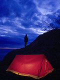 Camper Standing by Red Tent, Alaska Photographic Print by Mike Robinson