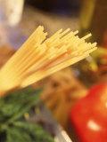 Dry Pasta, Grater, Tomato, and Herbs Fotografisk trykk av Ellen Kamp