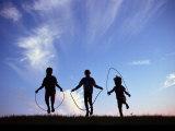 Silhouette of Children Playing Outdoors Lámina fotográfica por Mitch Diamond