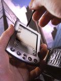 Hand Holding Palm Pilot M500 with Cell Phone Fotoprint van Ellen Kamp