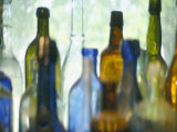 Abstract of Glass Bottles in Window Photographic Print by John Glembin