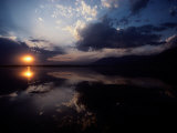 Sunset Sky Filled with Clouds is Reflected in the Water Photographic Print by Sam Abell