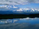 Cloud-Enshrouded Mt. Mckinley Reflected in Wonder Lake Photographic Print by Anne Keiser