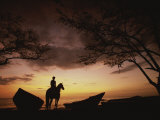 Horseback Rider Silhouetted on a Beach at Twilight, Costa Rica Fotografisk trykk av Michael Melford
