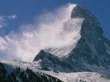 Snow Blows off of the Matterhorn Above Zermatt Stretched Canvas Print by Gordon Wiltsie