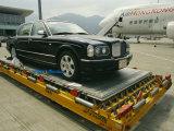 Luxury Bentley Unloaded from an Airplane at Chek Lap Kok Airport Fotografisk trykk av  xPacifica