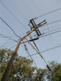 Tangled Wires Stretch in Four Directions from a Telephone Pole Photographic Print by Sam Kittner