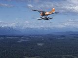 A Cessna Plane Flies over Backcountry Air Lanes Near the Alaska Range Reproduction photographique par Ira Block
