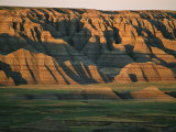 Sunset on the Eroded Land Formations of the Badlands Fotoprint av Annie Griffiths Belt