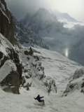 An Extreme Skier in Pas De Chevres Couloir Mount Blanc is in the Background Stretched Canvas Print by Gordon Wiltsie