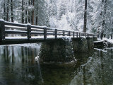 A Snow-Covered Footbridge Spanning the Merced River Photographic Print by Marc Moritsch