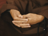 Close View of a Monks Hands Crossed in Prayer Fotografisk tryk af W. E. Garrett