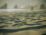 A Windsurfer Walks Across the Sand Dunes Near the Rocky Coastline Reproduction photographique par Skip Brown