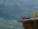 A Hiker Resting at a Cliffs Edge Photographic Print by Dugald Bremner