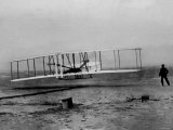 Orville Wright Taking Plane For 1st Motorized Flight as Brother Wilbur Wright Looks at Kitty Hawk Lámina fotográfica