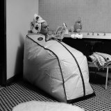 Woman Sitting in a Portable Finnish Sauna Bath Photographic Print by Yale Joel