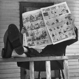 Man Reading the Comics Section of the Detroit Times on a Typical Sunday During WWII Photographic Print by Walter Sanders