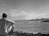 US Sailor Watching Navy Vessels on the Horizon Photographic Print by Carl Mydans