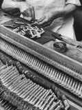 Workman Installing Some of the Whippens, Shanks and Hammers at the Steinway Piano Factory Reproduction photographique par Margaret Bourke-White