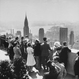 Sightseers Taking a Guided Tour on Top of the Rockefeller Center Post Office's Roof Photographic Print by Bernard Hoffman