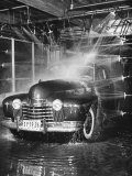 Car Rolling Through the Car Wash at Rockefeller Center Photographic Print by Bernard Hoffman