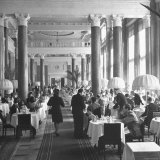 People Dining in the Hotel Dining Room Photographic Print by Thomas D. Mcavoy