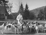 Man Standing with Group of Hounds at Rolling Rock Fox Hunt Photographic Print by Thomas D. Mcavoy