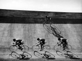 Bicycles Forming Distorted Designs on Track as Peddlers Grind Away in the 4,000 Meter Team Pursuit Reproduction photographique par Ralph Crane