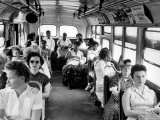 African American Citizens Sitting in the Rear of the Bus in Compliance with Florida Segregation Law Reproduction photographique par Stan Wayman