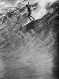 Surfer Riding a Giant Wave Photographic Print by George Silk