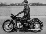 German Made BMW Motorcycle with a Rider Dressed in Black Leather Fotografie-Druck von Ralph Crane