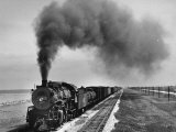 View of a Freight Train Crossing an Open Prairie Photographic Print by Thomas D. Mcavoy