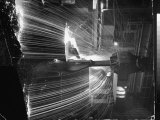 Molten Steel Being Poured from an Open Hearth Furnace at Carnegie Illinois Steel Mill Photographic Print by Andreas Feininger