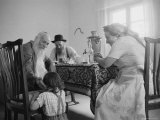 Members of a Jewish Family Sitting Down For a Meal Photographic Print by Paul Schutzer
