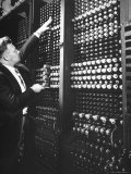 Technician Manipulating 1 of Hundreds of Dials on Panel of IBM's Room Size Eniac Computer Photographic Print by Francis Miller