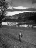 Scottish Farm Girl Walking Along a Trail Where Wordsworth Wrote Some of His Poetry Reproduction photographique par Nat Farbman