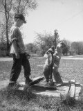 Two Boys Getting Water from a Pump at Rural School Photographic Print by Thomas D. Mcavoy