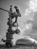 Workman Standing on Machinery at Natural Gas Plant Photographic Print by Thomas D. Mcavoy