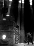 Worker Shoveling Limestone Into an Electric Blast Furnace at Republic Steel Mill Photographic Print by Margaret Bourke-White