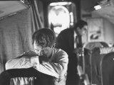 Thoughtful Senator Robert F. Kennedy on Airplane During Campaign Trip to Aid Local Candidates Fotografie-Druck von Bill Eppridge
