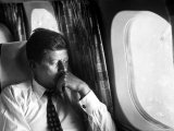 Senator John F. Kennedy on His Private Plane During His Presidential Campaign Reproduction photographique par Paul Schutzer