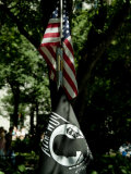 American Flag Hanging Above a Pow-Mia Flag in a Park in New York Fotoprint van Todd Gipstein